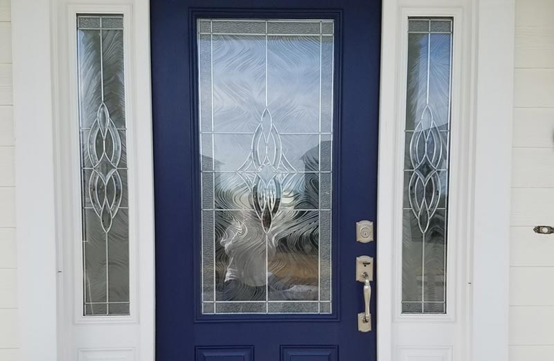 Prix d'une porte d'entrée en bois vitrée